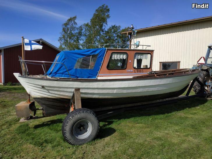 Träbåt med glasfiber